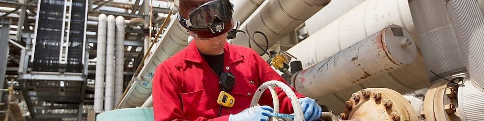 An engineer checks platform equipment for safety