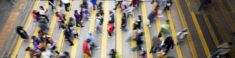 People crossing a busy street in Hong Kong
