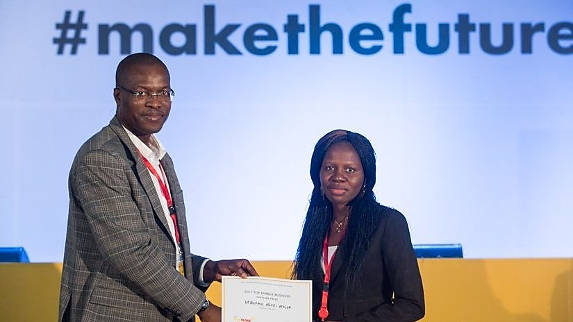 General Manager External Relations of Shell Petroleum Development Company, Mr. Igo Weli, presenting the prize for the best pitch to Mrs. Ngozi Atalor at the Shell LiveWIRE #makethefuture Accelerator event in Port Harcourt.